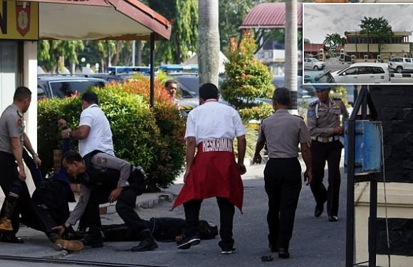Militants with suicide vests attack Indonesian police with swords