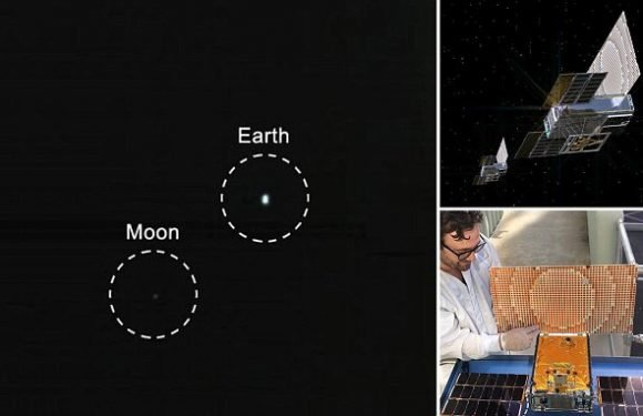 Fascinating image shows Earth and the moon as tiny specks in space