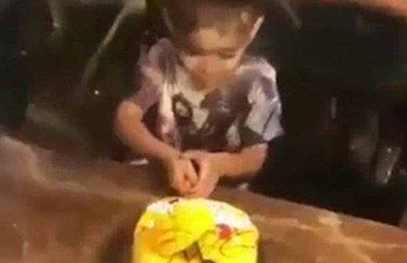 Indonesian birthday boy drenched in egg yolk while cutting his cake