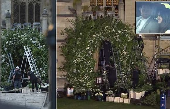 Florists apply final touches to HUGE floral archway for royal wedding