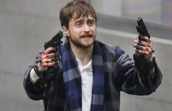 Daniel Radcliffe gets trigger happy on the set of new movie Guns Akimbo