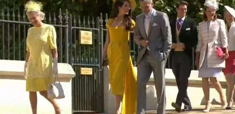 Amal Clooney stuns in canary yellow and a chic hat at royal wedding