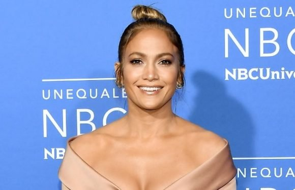 Jennifer Lopez Shows Off Her Amazingly Toned Legs In A Tiny Miniskirt