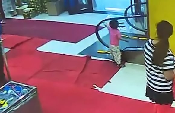 Toddler's hand gets sucked into escalator as he plays with moving rail