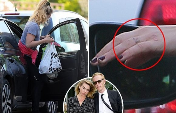 Billie Piper spotted with faded tattoo tribute to ex-husband Laurence Fox after 'undergoing laser removal'