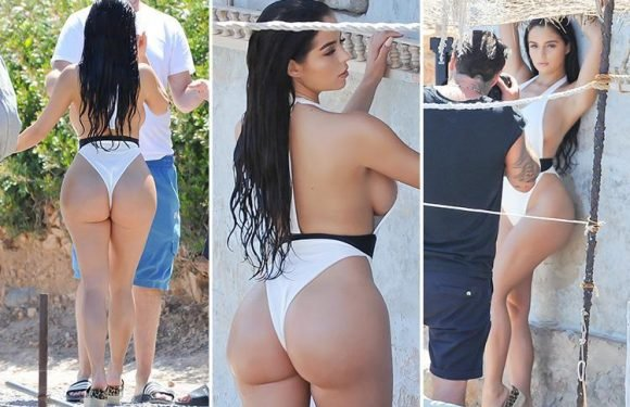 Demi Rose flashes her bum in a thong swimsuit as she poses for a photoshoot in Ibiza