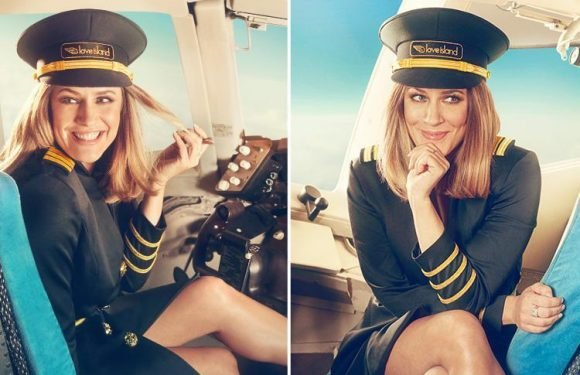 Caroline Flack flashes her long legs in a pilot's outfit in new Love Island advert