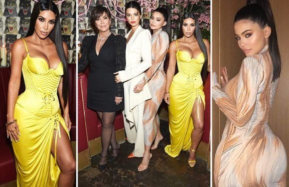 Kim Kardashian and Kylie Jenner battle to be the queen of curves in skintight dresses as they join mum Kris and sister Kendall at showbiz bash