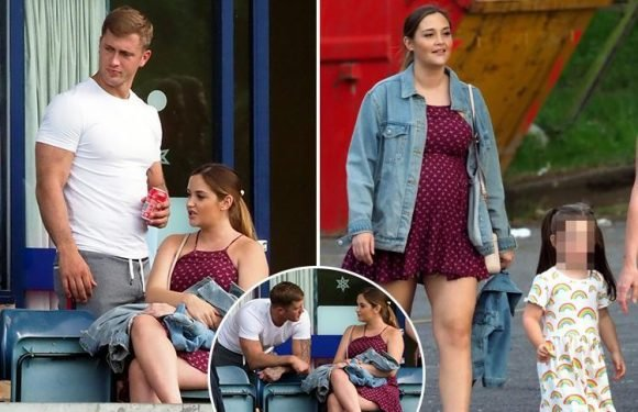 Pregnant Jacqueline Jossa is all smiles as she supports Dan Osborne at charity football match after split