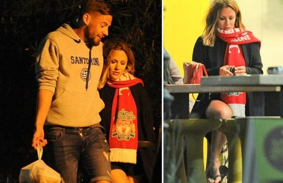 Caroline Flack dons boyfriend Andrew Brady's Liverpool FC scarf after watching the match on romantic engagement holiday in Greece