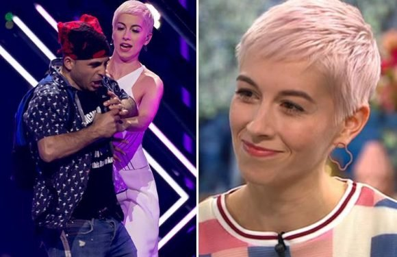 Eurovision star SuRie reveals her injuries after grappling with stage invader as she speaks for the first time about shocking incident