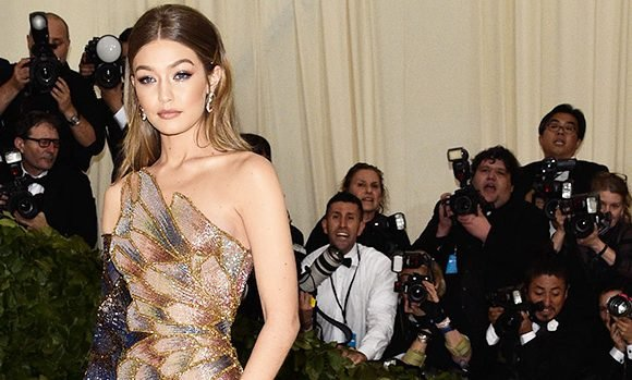 Gigi Hadid Stuns In Stained Glass Inspired Gown With Thigh-High Slit At Met Gala