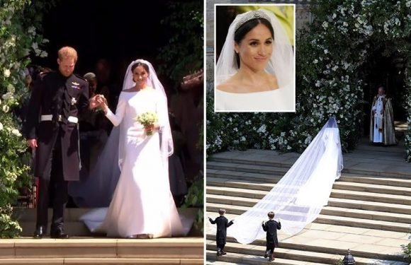 Meghan Markle stuns in a bespoke white silk Givenchy wedding dress and 15ft veil embroidered with flowers of the Commonwealth