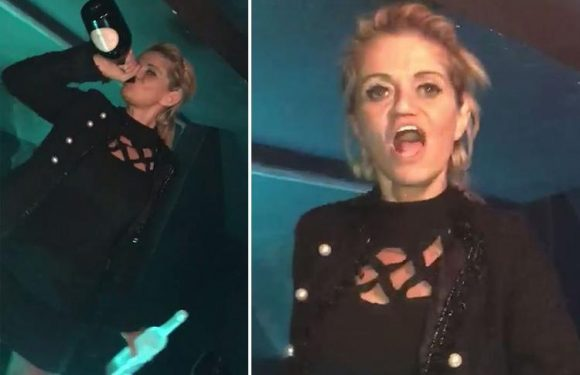 Danniella Westbrook flashes her knickers and swigs from a bottle of champagne as she celebrates her bail charges being dropped