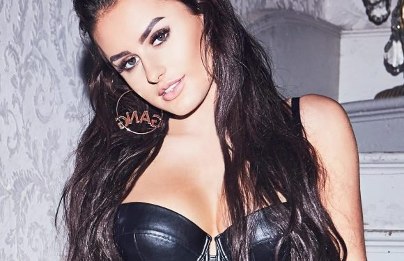 Love Island's Amber Davies puts on leather corset for calendar shoot