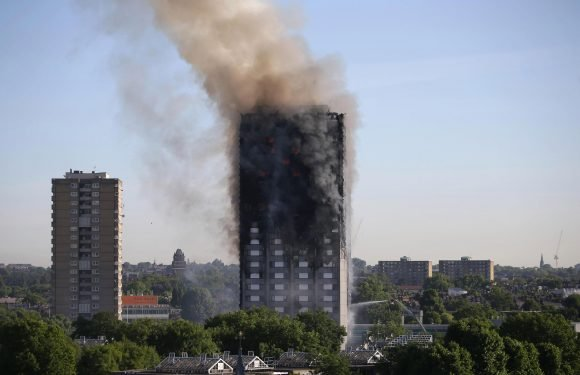 Theresa May pledges £400million to remove Grenfell-style covering from high rises
