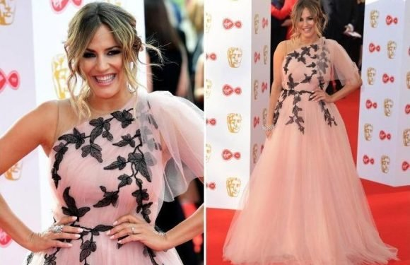 Caroline Flack proudly shows off her engagement ring from fiancé Andrew Brady at BAFTAs