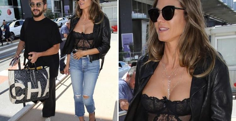 Heidi Klum is racy in a sheer lace basque as she jets into Nice airport with new beau Tom Kaulitz