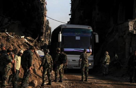 Insurgents start leaving south Damascus pocket, release hostages