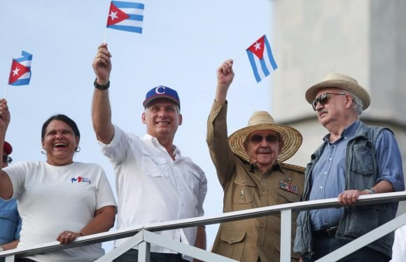 In show of continuity, Castro flanks new Cuban leader at May Day rally