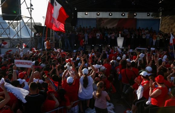 Supporters cheer Maltese leader as govt faces pressure after…