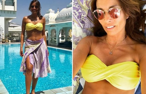 Melanie Sykes, 47, shows off her amazing abs in yellow bikini while on holiday in India