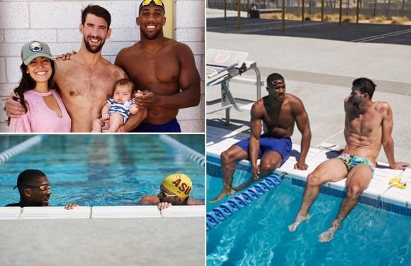 Anthony Joshua finally loses unbeaten record… as he races against Olympic legend Michael Phelps on US holiday