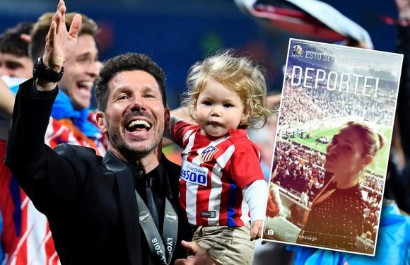 Atletico Madrid manager Diego Simeone's girlfriend Carla Pereyra and family rush onto pitch to celebrate with him after Europa League triumph over Marseille