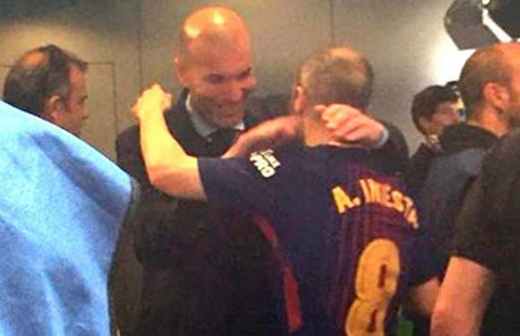 Real Madrid boss Zinedine Zidane and Barcelona midfielder Andres Iniesta in touching embrace after El Clasico