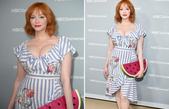 Christina Hendricks flaunts her curves in tight dress paired with a watermelon clutch on the red carpet