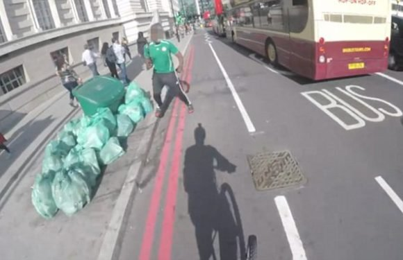 A cyclist trying to clear bike lanes of pedestrians uses a CAR HORN