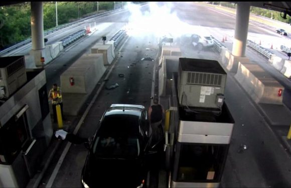 Terrifying moment car smashes into toll booth at high speed