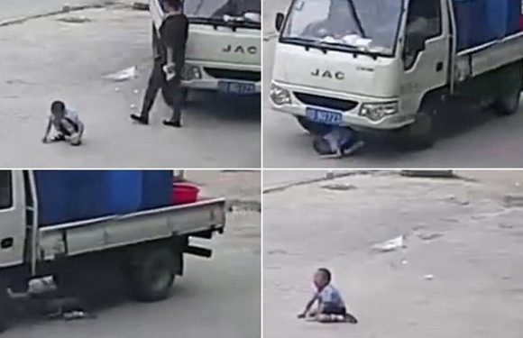 Boy cheats death after being run over by a truck while playing