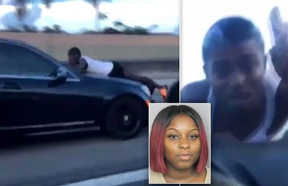 Woman caught on camera speeding down the highway with her ex on hood