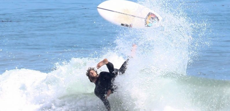 Liam Hemsworth Wipes Out During a Malibu Surf Session — Somebody Call Miley Cyrus!