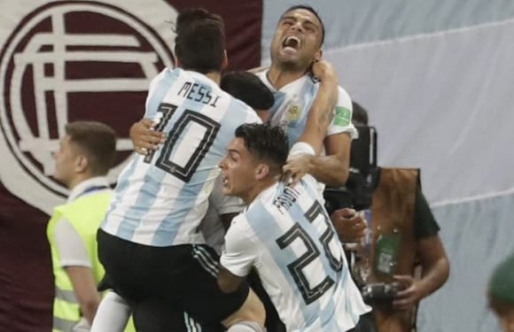 Argentina strike late to advance to last 16