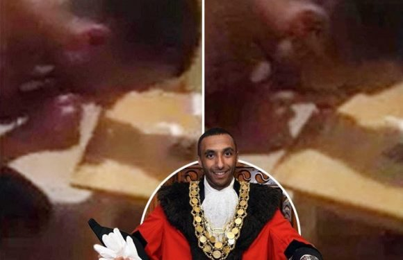Town's first black mayor caught on camera snorting a white powder claims video is being used by racists to smear him