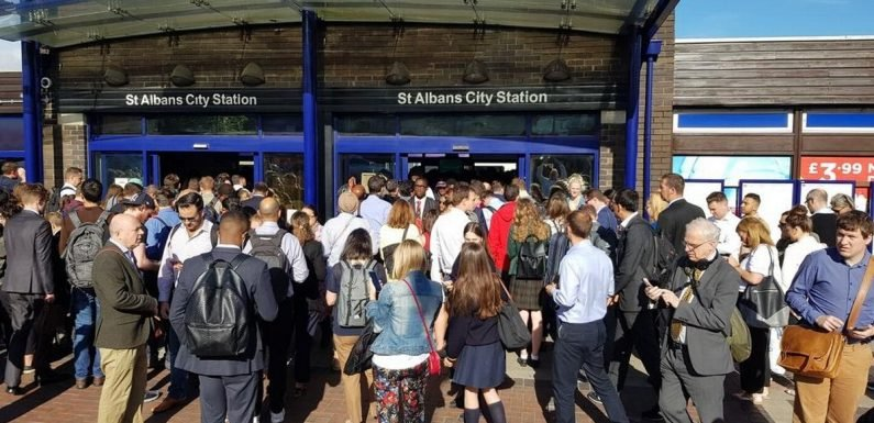 Angry commuters 'kick down gates' at train station after major delays