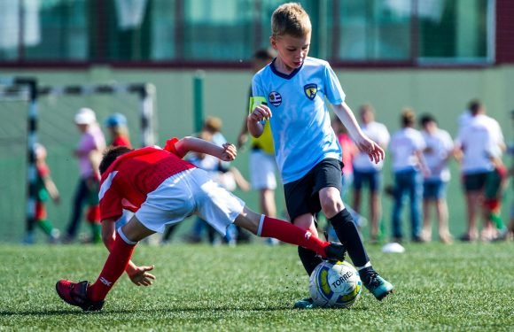Boys far more likely than girls to play sport outside of school, researchers claim