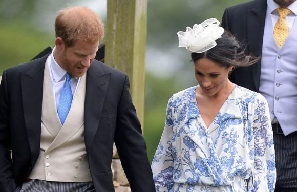 Meghan Markle stumbles in white heels as Harry keeps firm grip on her hand