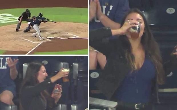 Baseball fan catches ball in cup of beer while holding mobile phone… before necking pint