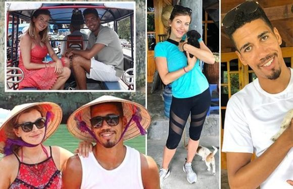 Chris Smalling gets over England World Cup snub by travelling through Asia with stunning wife Sam Cooke