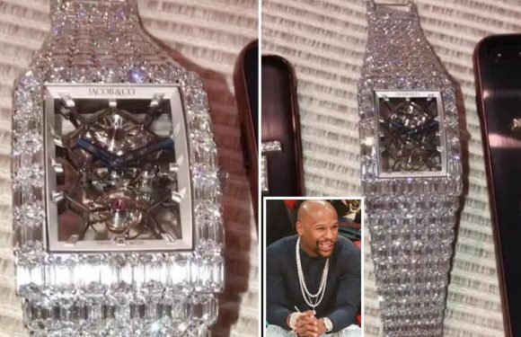 Floyd Mayweather shows off stunning £13.75m diamond-encrusted watch the boxing legend got after 50th career win over Conor McGregor