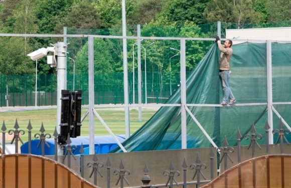 England training HQ turned into a fortress with 7ft fences to keep out 'spies'