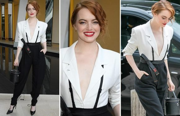 Emma Stone, 29, looks classy in Louis Vuitton low-cut white blazer and stark black trousers