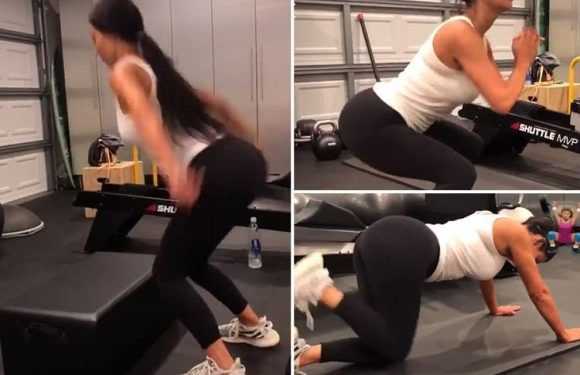 Kim Kardashian sculpts her famous bum as she squats and jumps in the gym