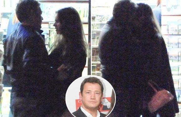 EastEnders legend Sid Owen passionately kisses a mystery woman in the street after night out