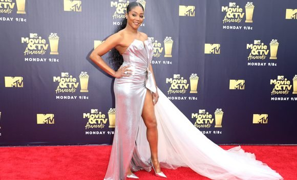 Tiffany Haddish Slays In Silver Gown On The MTV Movie & TV Awards Red Carpet