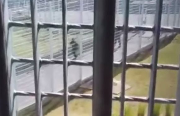 The moment French gangster flees prison in hijacked chopper