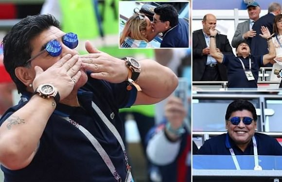 Maradona sends kisses to the crowd as he watches Argentina